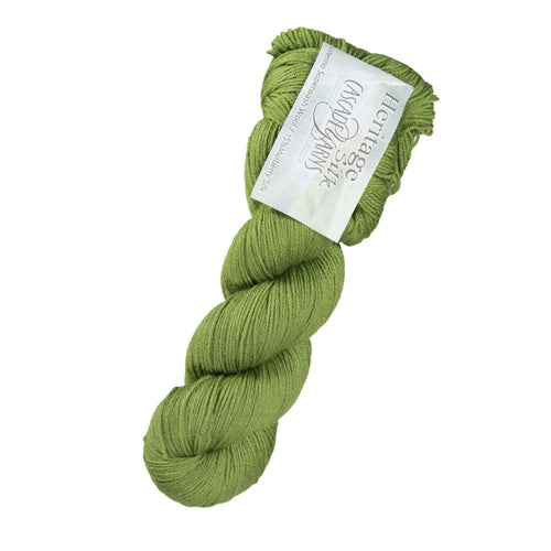 Skein of Cascade Heritage Silk Sock weight yarn in the color Camo Green (Green) for knitting and crocheting.