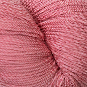 Skein of Cascade Heritage Silk Sock weight yarn in the color Coral Rose (Pink) for knitting and crocheting.