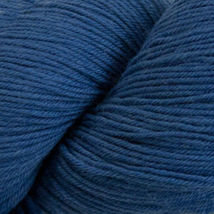 Skein of Cascade Heritage Silk Sock weight yarn in the color Denim (Blue) for knitting and crocheting.