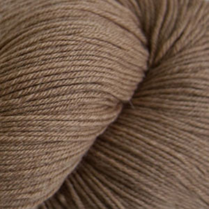 Skein of Cascade Heritage Sock weight yarn in the color Camel (Tan) for knitting and crocheting.