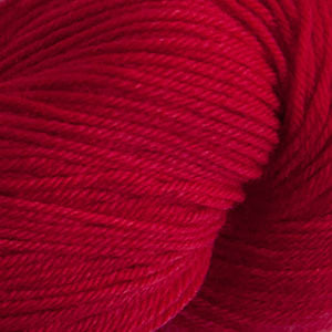 Skein of Cascade Heritage Sock weight yarn in the color Christmas Red (Red) for knitting and crocheting.