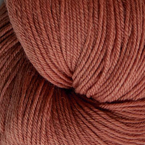 Skein of Cascade Heritage Sock weight yarn in the color Cinnamon (Orange) for knitting and crocheting.
