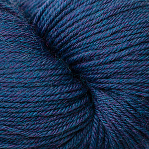 Skein of Cascade Heritage Sock weight yarn in the color Lapis Heather (Blue) for knitting and crocheting.