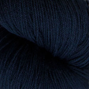 Skein of Cascade Heritage Sock weight yarn in the color Navy (Blue) for knitting and crocheting.