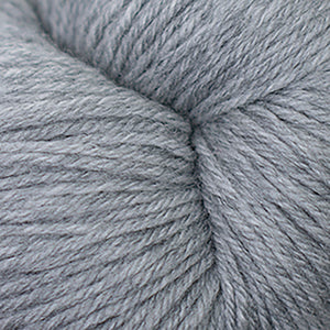 Skein of Cascade Heritage Sock weight yarn in the color Silver Grey (Gray) for knitting and crocheting.