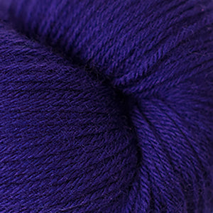 Skein of Cascade Heritage Sock weight yarn in the color Violet Indigo (Purple) for knitting and crocheting.