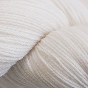 Skein of Cascade Heritage Sock weight yarn in the color White (White) for knitting and crocheting.