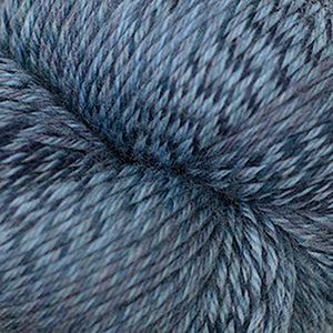 Skein of Cascade Heritage Wave Sock weight yarn in the color Blues (Blue) for knitting and crocheting.