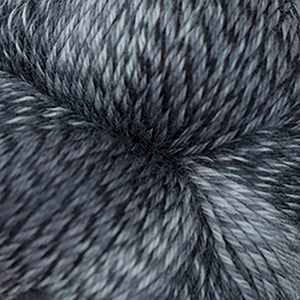 Skein of Cascade Heritage Wave Sock weight yarn in the color Graphite (Black) for knitting and crocheting.