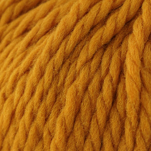 Skein of Cascade Llana Grande Super Bulky weight yarn in the color Artisan Gold (Yellow) for knitting and crocheting.