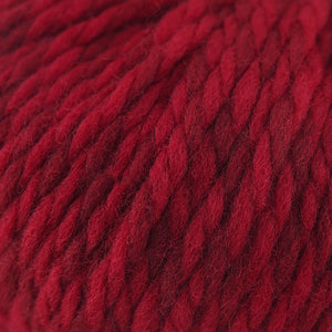Skein of Cascade Llana Grande Super Bulky weight yarn in the color Crimson (Red) for knitting and crocheting.