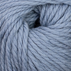 Skein of Cascade Llana Grande Super Bulky weight yarn in the color Dusty Blue (Blue) for knitting and crocheting.