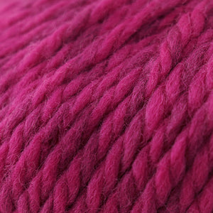 Skein of Cascade Llana Grande Super Bulky weight yarn in the color Hot Rod Pink (Pink) for knitting and crocheting.