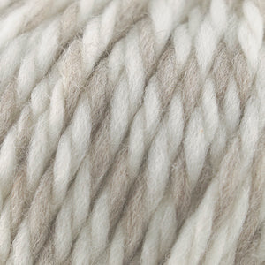 Skein of Cascade Llana Grande Super Bulky weight yarn in the color Irish Oatmeal (Cream) for knitting and crocheting.