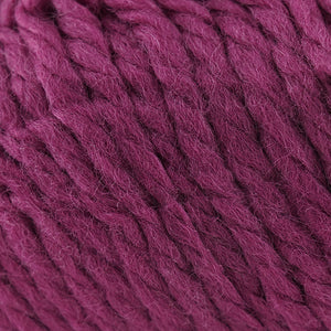 Skein of Cascade Llana Grande Super Bulky weight yarn in the color Raspberry Radiance (Pink) for knitting and crocheting.