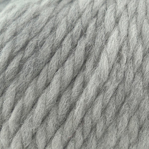 Skein of Cascade Llana Grande Super Bulky weight yarn in the color Silver Grey (Gray) for knitting and crocheting.