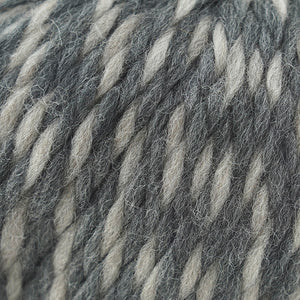 Skein of Cascade Llana Grande Super Bulky weight yarn in the color Space Needle (Gray) for knitting and crocheting.