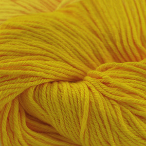 Skein of Cascade Nifty Cotton Worsted weight yarn in the color Gold (Yellow) for knitting and crocheting.