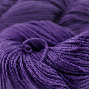 Skein of Cascade Nifty Cotton Worsted weight yarn in the color Purple (Purple) for knitting and crocheting.