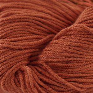 Skein of Cascade Nifty Cotton Worsted weight yarn in the color Terra Cotta (Orange) for knitting and crocheting.