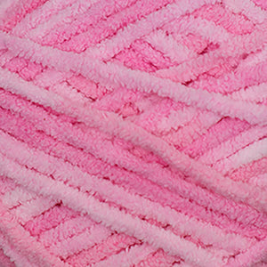 Skein of Cascade Pluff Bulky weight yarn in the color Pink (Pink) for knitting and crocheting.