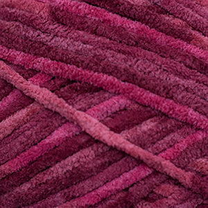 Skein of Cascade Pluff Bulky weight yarn in the color Red (Red) for knitting and crocheting.