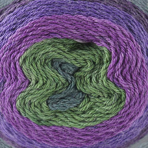 Skein of Cascade Whirligig DK weight yarn in the color Grapevine (Purple) for knitting and crocheting.