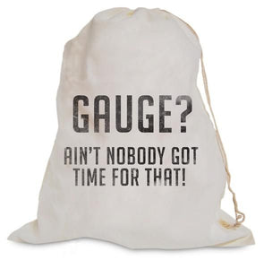 "White muslin bag with graphic ""Gauge, Ain't Nobody Got Time for That"" for holding knitting or crochet projects."