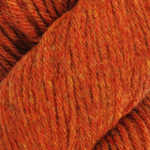 Skein of Juniper Moon Farms Santa Cruz Worsted weight yarn in the color Cinnamon (Orange) for knitting and crocheting.
