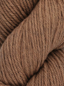 Skein of Juniper Moon Farms Santa Cruz Worsted weight yarn in the color Driftwood (Brown) for knitting and crocheting.