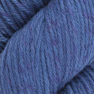 Skein of Juniper Moon Farms Santa Cruz Worsted weight yarn in the color Indigo (Blue) for knitting and crocheting.
