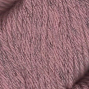 Skein of Juniper Moon Farms Santa Cruz Worsted weight yarn in the color Morganite (Pink) for knitting and crocheting.