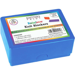 Box of Knitter's Pride colorful blocking pins for knitting and crochet projects.
