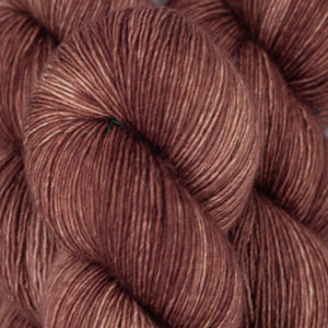Skein of Madelinetosh A.S.A.P. Super Bulky weight yarn in the color Cold Drip (Brown) for knitting and crocheting.