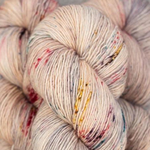 Skein of Madelinetosh A.S.A.P. Super Bulky weight yarn in the color Leaf Fall (Pink) for knitting and crocheting.