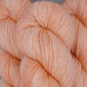 Skein of Madelinetosh A.S.A.P. Super Bulky weight yarn in the color Pink Clay (Pink) for knitting and crocheting.