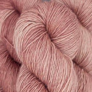 Skein of Madelinetosh A.S.A.P. Super Bulky weight yarn in the color Smoke Tree (Pink) for knitting and crocheting.