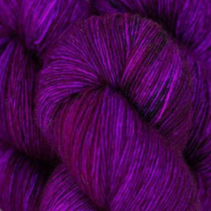 Skein of Madelinetosh A.S.A.P. Super Bulky weight yarn in the color Wino Forever (purple) for knitting and crocheting.
