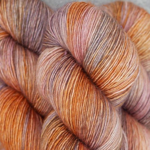 Skein of Madelinetosh A.S.A.P. Super Bulky weight yarn in the color Brick Dust (Brown) for knitting and crocheting.