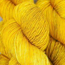 Load image into Gallery viewer, Skein of Madelinetosh A.S.A.P. Super Bulky weight yarn in the color Candlewick (Yellow) for knitting and crocheting.