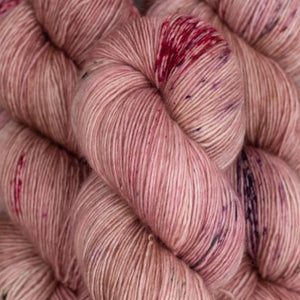 Skein of Madelinetosh A.S.A.P. Super Bulky weight yarn in the color Copper Pink (Pink) for knitting and crocheting.