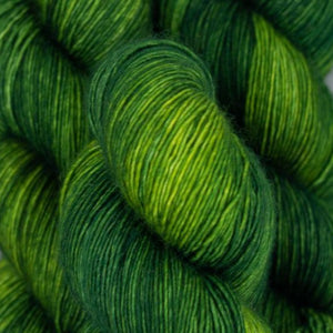 Skein of Madelinetosh A.S.A.P. Super Bulky weight yarn in the color Jade (Green) for knitting and crocheting.