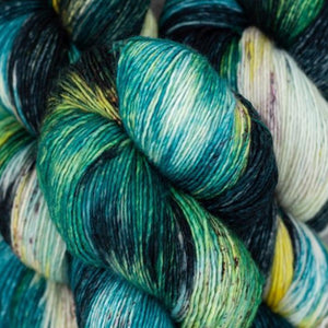 Skein of Madelinetosh A.S.A.P. Super Bulky weight yarn in the color Jaded Dreams (Blue) for knitting and crocheting.