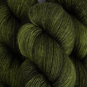 Skein of Madelinetosh A.S.A.P. Super Bulky weight yarn in the color Joshua Tree (Green) for knitting and crocheting.