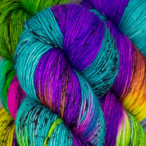Skein of Madelinetosh A.S.A.P. Super Bulky weight yarn in the color Pinata Pop (Multi) for knitting and crocheting.