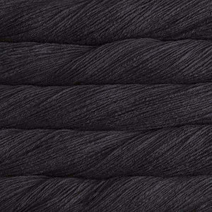 Skein of Malabrigo Arroyo Sport weight yarn in the color Black (Cream) for knitting and crocheting.