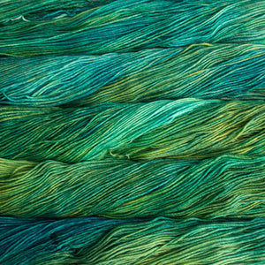 Skein of Malabrigo Arroyo Sport weight yarn in the color Immortal (Green) for knitting and crocheting.