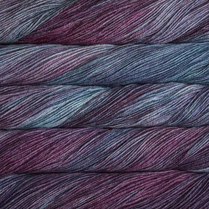 Skein of Malabrigo Arroyo Sport weight yarn in the color Lotus (Purple) for knitting and crocheting.