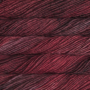 Skein of Malabrigo Mecha Bulky weight yarn in the color Cereza (Red) for knitting and crocheting.