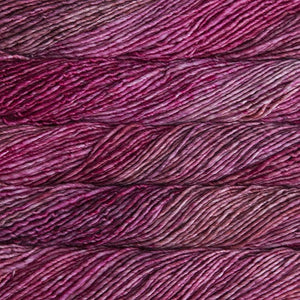 Skein of Malabrigo Mecha Bulky weight yarn in the color English Rose (Pink) for knitting and crocheting.